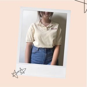 Yellow collared top with watering can embroidery